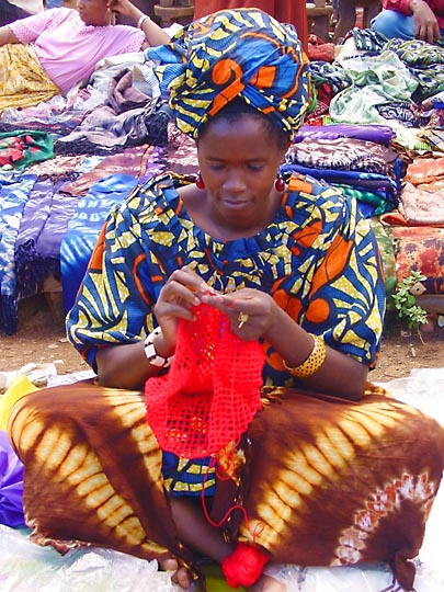 A local African knits in the Nairobi market, Kenya 2000