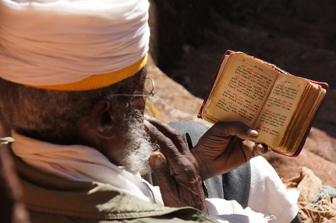 A monk prays in front of a rock-hewn Church, Lalibela 2012