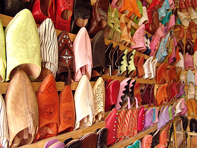 Display of colorful slippers in a market stand, The Medina (old city) 2007
