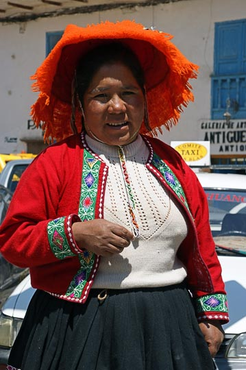 A Chola (local woman) with a decorated hat in the street, Cusco 2008