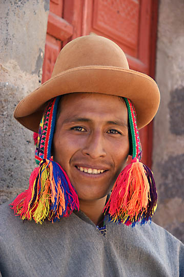 An Amerindian man with traditional hats in the street, Cusco 2008