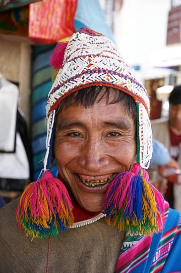 An Amerindian man with traditional beaded hat in the market, Cusco 2008