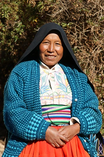 Eusevia with her traditional cloths by her house, Amantani Island, Lake Titicaca 2008