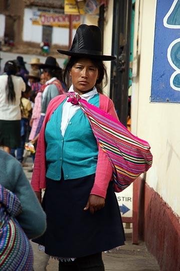 A Chola (local woman) with a decorated hat in the street, Marcara 2008