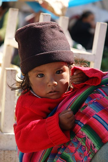A baby girl carried by her mom in the market, Cusco 2008