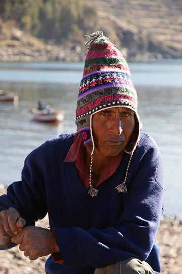 A local man with a warm and colorful knitted hat at the Wednesday morning market, Amantani Island, Lake Titicaca 2008
