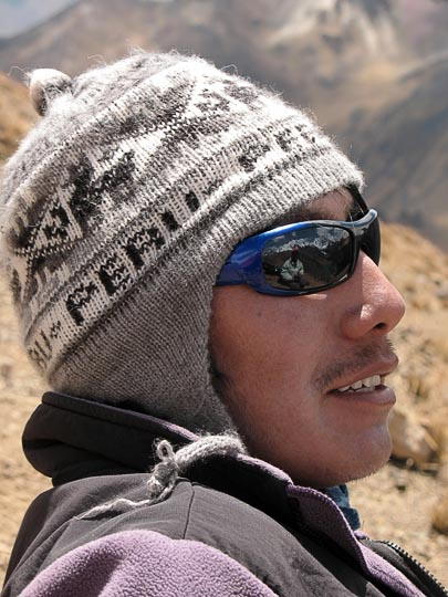 Angel Callupe and me reflected in his sunglasses, Mount Huacrish 2008 (photographed by Aviv Halman)