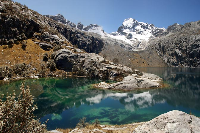 The reflection of Churup Mountain in the blue green rich color of Churup Lake, Cordillera Blanca 2008
