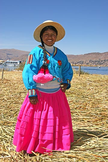A young girl in traditional clothing, on the Totora reeds man-made Uros Islands, Lake Titicaca 2008