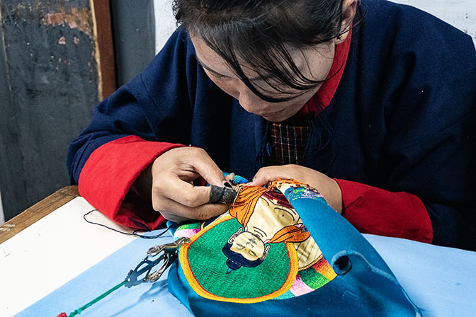 A young woman embroidering at a traditional arts school in Thimphu, 2018