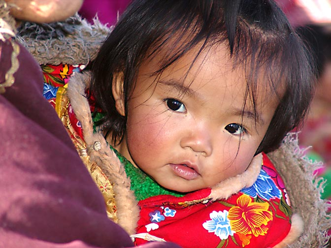 A Tibetan girl in a crowded ferry boat on the way to Samyai Monastery, 2004
