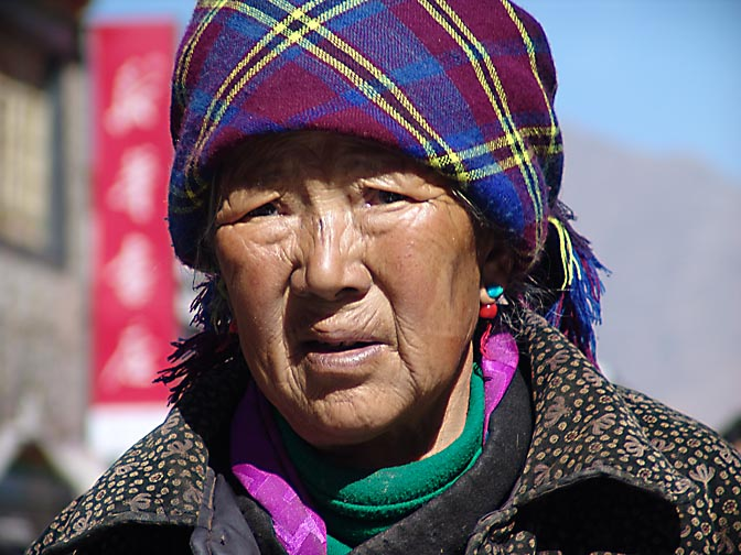A Tibetan woman along by the Lingkor around the Jokhang, Lhasa 2004