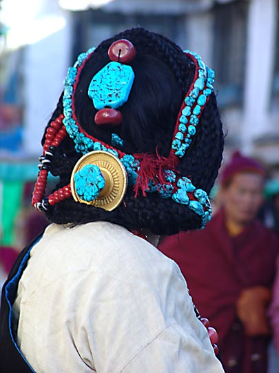 Beads, interlaced in Tibetan woman's hair, along by the Lingkor around the Jokhang, Lhasa 2004