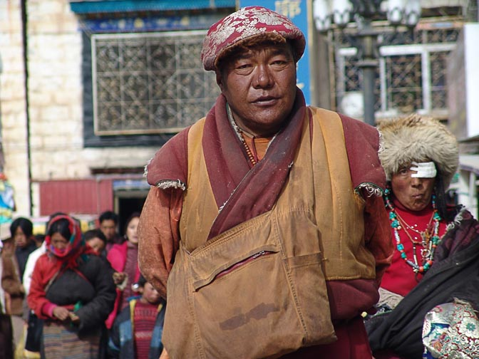 A Tibetan man along by the Lingkor around the Jokhang, Lhasa 2004