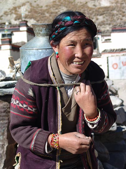 A Tibetan woman carrying a water jar close to Lhasa, 2004