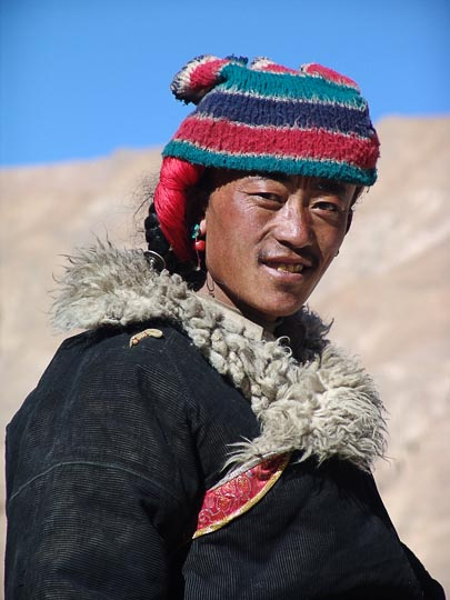 A colorful Tibetan man nearby Old Tingri, 2004