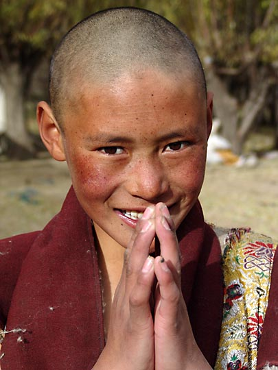 A young Tibetan posing the Tibetan greeting 'Tashi Delek' (good luck), in Samyai Monastery, 2004