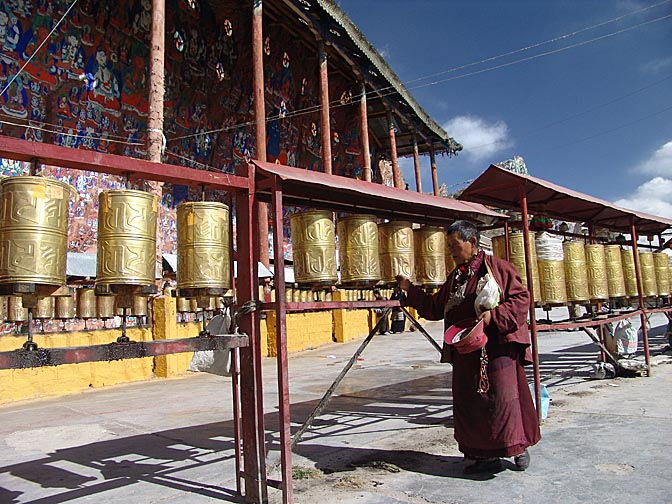 Prayer wheels and  Blue Buddha carvings in Chakpori, Lhasa 2004