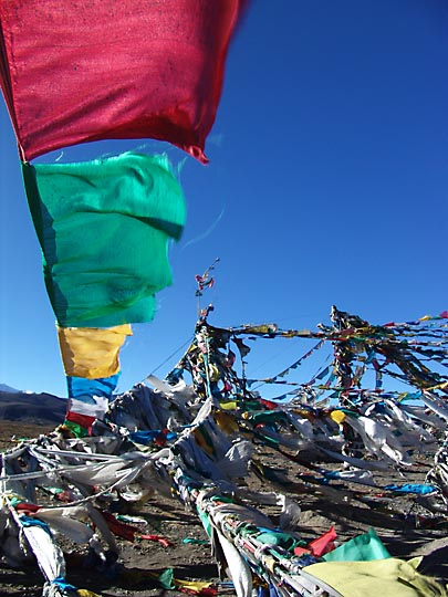 Colorful prayer flags fluttering in Lhakpa La (5,220m), 2004