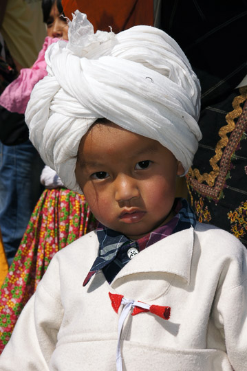 Boy dressed as a traditional Rung, Pangu 2011