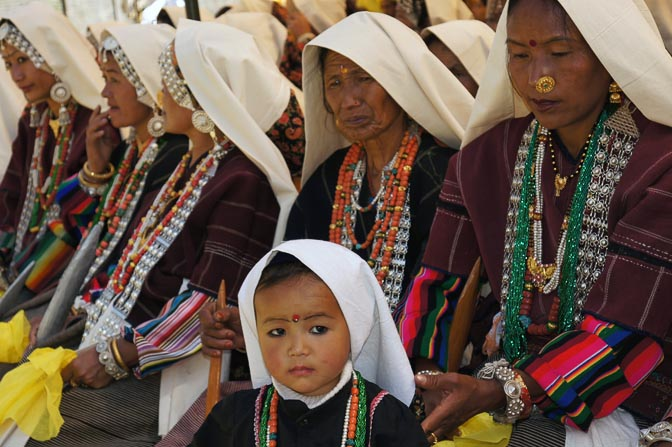 Child and women dressed in traditional Rung, Pangu 2011