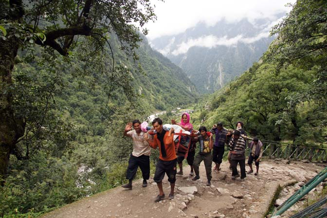Sikh pilgrims are carried on sedan chairs to the sacred lake Hemkund, Garhwal Himalayas 2011