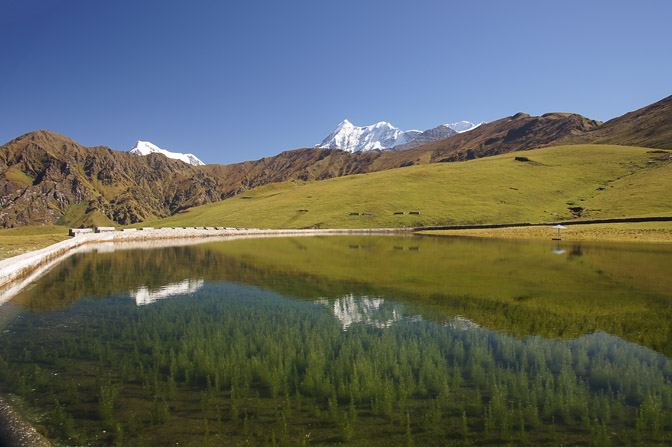 The Himalaya peaks reflect in a lake in Bedni Bugyal, Roopkund trek 2011