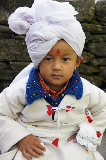 A young kid in a traditional Rung costume to honor the Vijayadashami/Dasara Puja, Pangu 2011