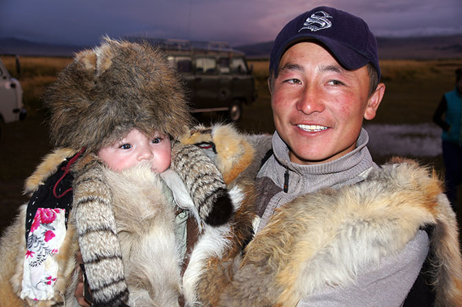 Mongolian-Kazakh nomad and his son, 2014