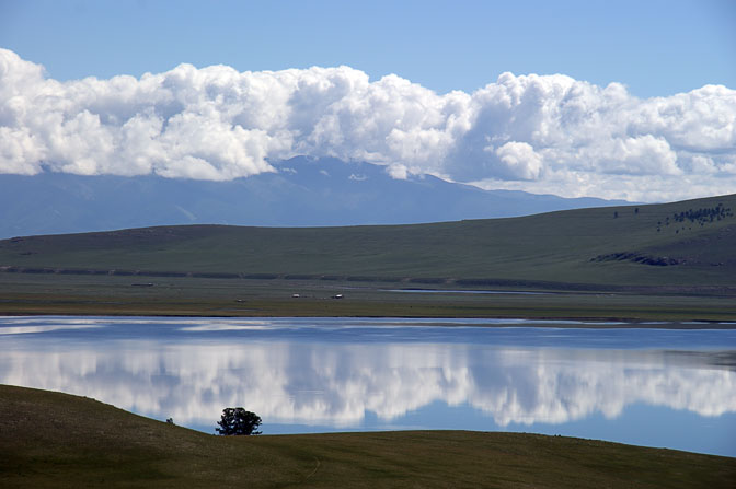 Blue sky and white clouds reflection in Targan Nuur (lake), North Mongolia 2010