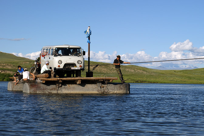 A UAZ Furgon car on a ferry crossing the Shishged Gol (river), North Mongolia 2010
