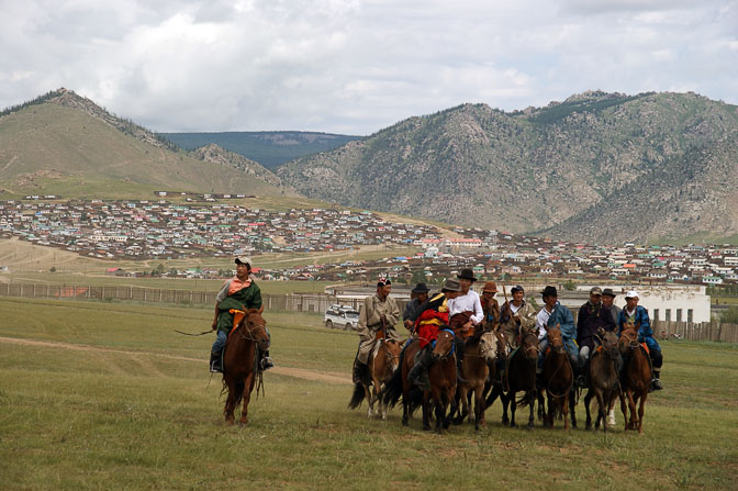 Horsemen come to watch the finish line of the 30 km horse-race, the third game at the Naadam festival, Tsetserleg 2010