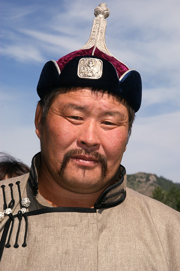 A wrestler in traditional Mongolian hat and robe, Tsetserleg 2010