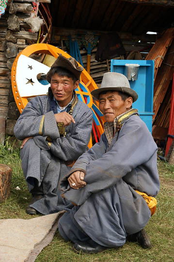 Two men wearing a Del (traditional Mongol coat) near Renchinlkhumbe, North Mongolia 2010