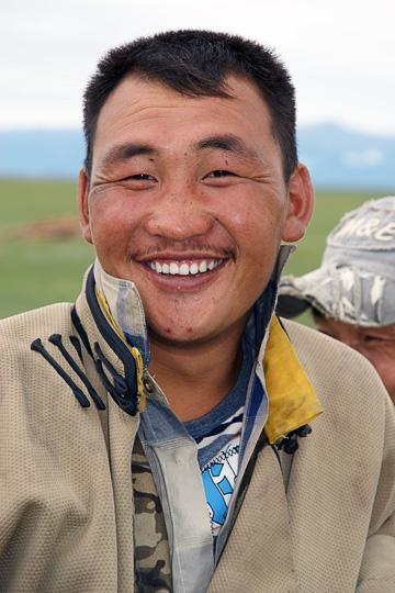 A man wearing a Mongolian coat near Renchinlkhumbe, North Mongolia 2010