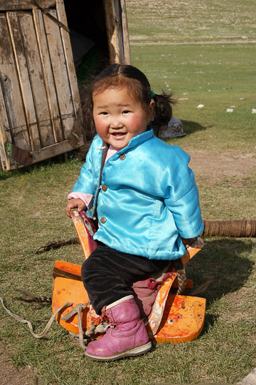 Girl astride on Mongolian saddle in Orkhon Valley, Central Mongolia 2010
