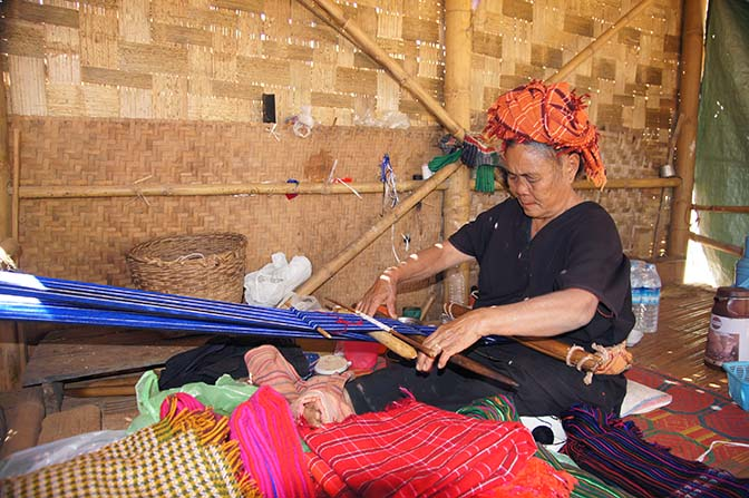 Pa O woman weaving colorful scarves in Hin Kha Bin village, Kalaw to Inle Lake trek 2015