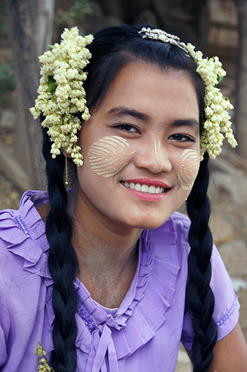 A local girl with traditional Thanaka wood (Hesperethusa crenulata) paste on her face, Innwa 2015