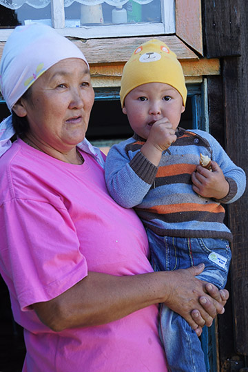 Grandmother and her grandson in Boochi village, 2014
