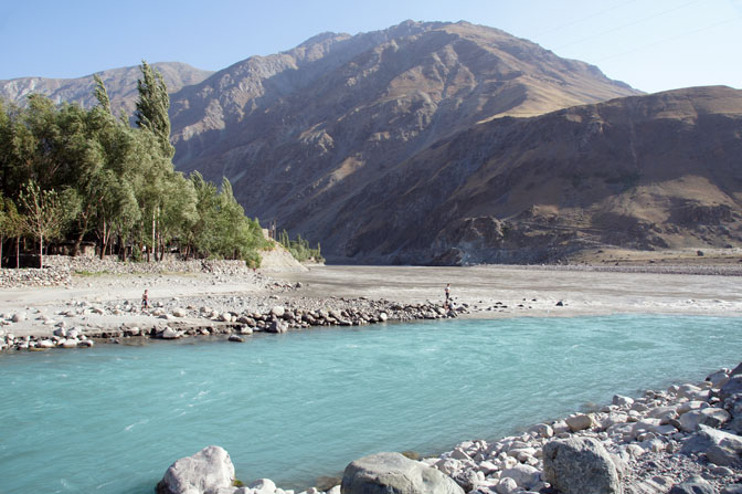 The Blue melting glacier water of the Obikhumbob merge with the flooding brown Panj (Pyandzh) river, Qalai-Khumb 2013