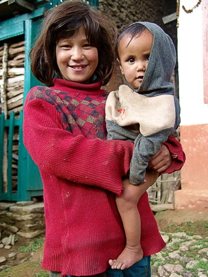 Carrying the Young in Chauki, along the Kangchenjunga Trek, Nepal 2006