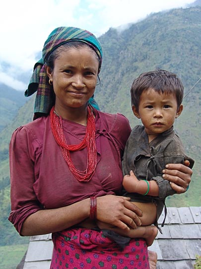 Carrying the Young on the way between Kenja and Sete, along the Khumbu Trail to the Everest, Nepal 2004