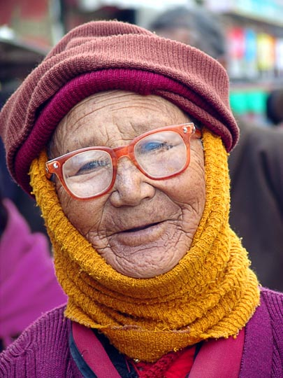 A portrait of a Tibetan woman on pilgrimage along the Lingkor around the Jokhang, Lhasa, Tibet, China 2004