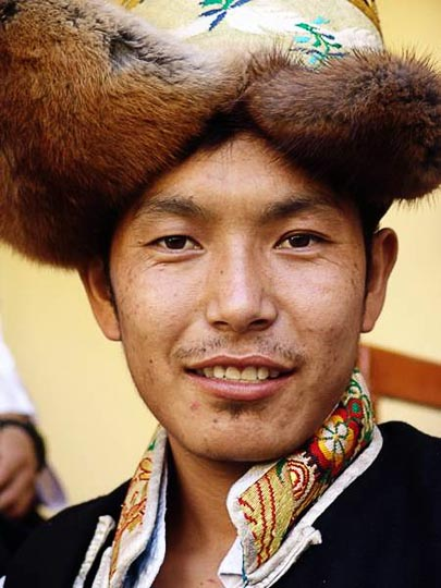 A portrait of a Tibetan dancer at the Karmapa birthday ceremony, in Gyuto Monastery in Sidmbari, Dharamsala, India 2004