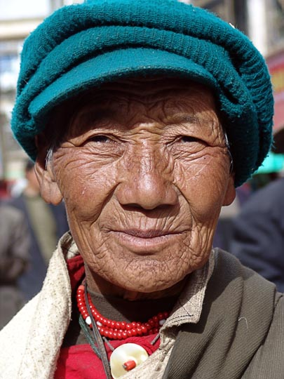 A Tibetan woman on pilgrimage along the Lingkor around the Jokhang, Lhasa, Tibet, China 2004