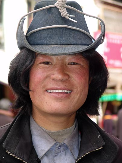 A young Tibetan man on pilgrimage along the Lingkor around the Jokhang, Lhasa, Tibet, China 2004