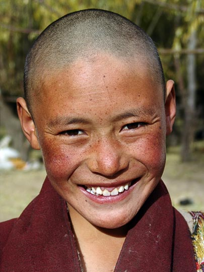 A young Tibetan boy in the Samyai Monastery, Tibet, China 2004
