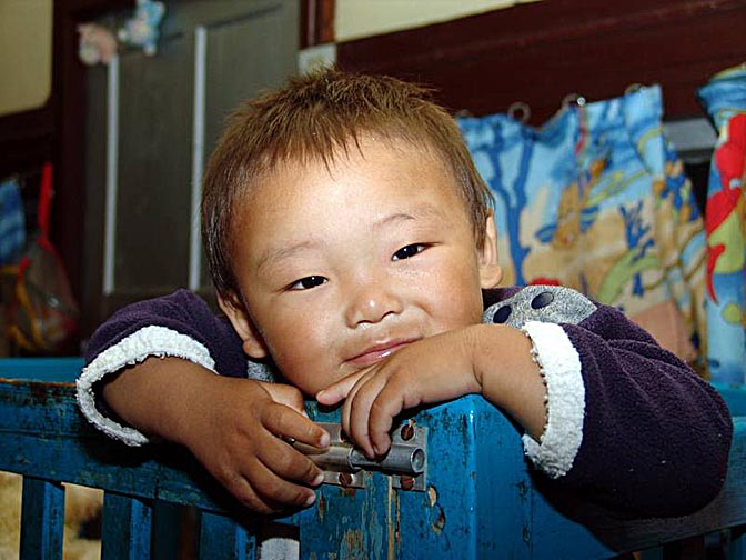 A Tibetan baby in the Tibetan Children Village in McLeod Ganj, Dharamsala, India 2004