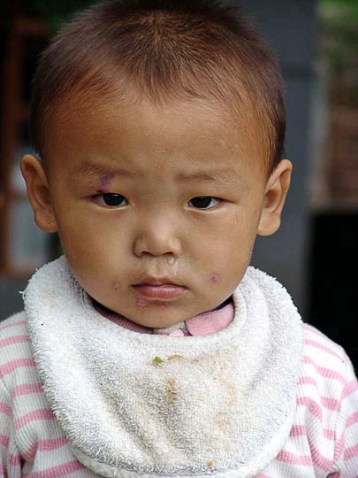 Tashi, a cute Tibetan baby, in the Tibetan Children Village in McLeod Ganj, Dharamsala, India 2004