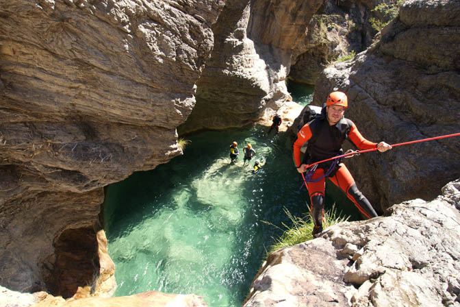 Dudi rappels down (abseils) the rushing waterfall in the Barbaira Canyon, Italy 2011